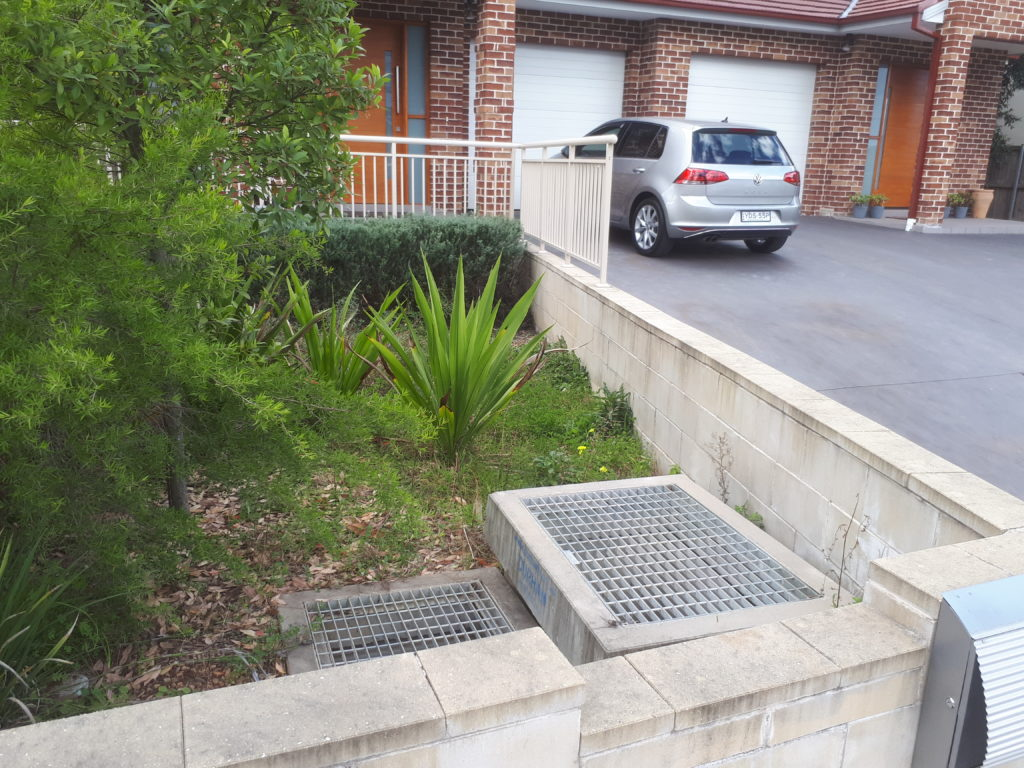 Residential building with storm drain under residential and homeowner regulation